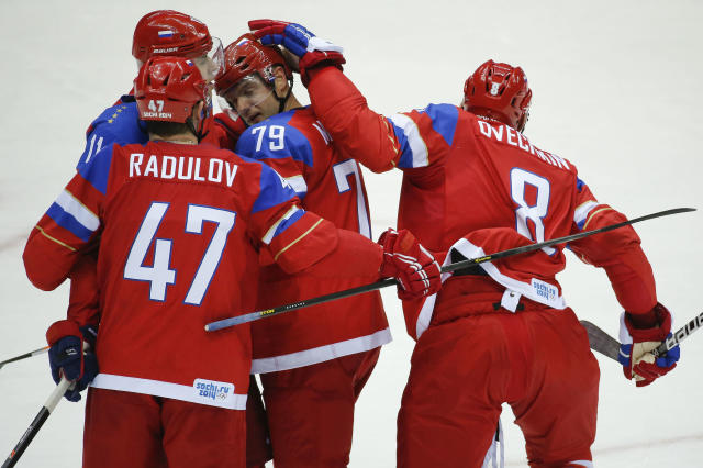 Russia forward Alexander Ovechkin taps defenseman Andrei Markov on the helmet after Markov scored a goal against Slovenia in the second period of a men's ice hockey game at the 2014 Winter Olympics, Thursday, Feb. 13, 2014, in Sochi, Russia. (AP Photo/Mark Humphrey)