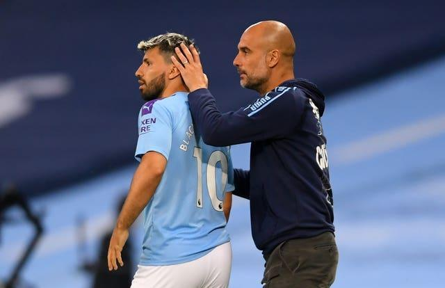 Guardiola (right) expects it to take time for Aguero (left) to get back to his best