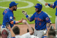 New York Mets' Tomas Nido (3) celebrates with Jonathan Villar (1) after hitting a solo home run during the ninth inning of the team's baseball game against the Atlanta Braves on Tuesday, May 18, 2021, in Atlanta. (AP Photo/John Bazemore)