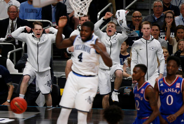 Villanova players on the bench react as Eric Paschall (4) dunks against Kansas during the second half in the semifinals of the Final Four NCAA college basketball tournament, Saturday, March 31, 2018, in San Antonio. (AP Photo/Brynn Anderson)
