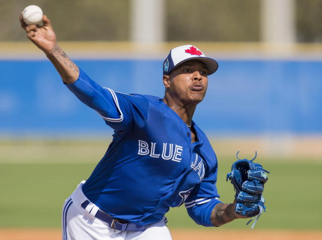 FILE - In this Feb. 21, 2018, file photo, Toronto Blue Jays starting pitcher Marcus Stroman throws during baseball spring training in Dunedin, Fla. Stroman was slowed by a sore right shoulder at spring training, but is expected to start Toronto's fourth game of the season, following left-hander J.A. Happ, Sanchez, and righty Marco Estrada. (Frank Gunn/The Canadian Press via AP)