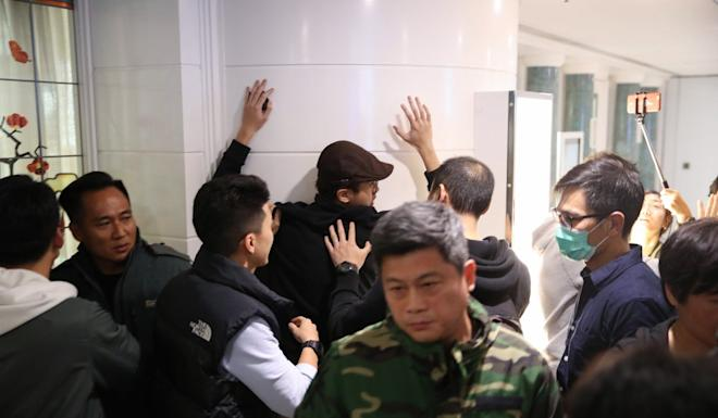 Officers dealing with a protester at Harbour City mall on December 21. Photo: Winson Wong