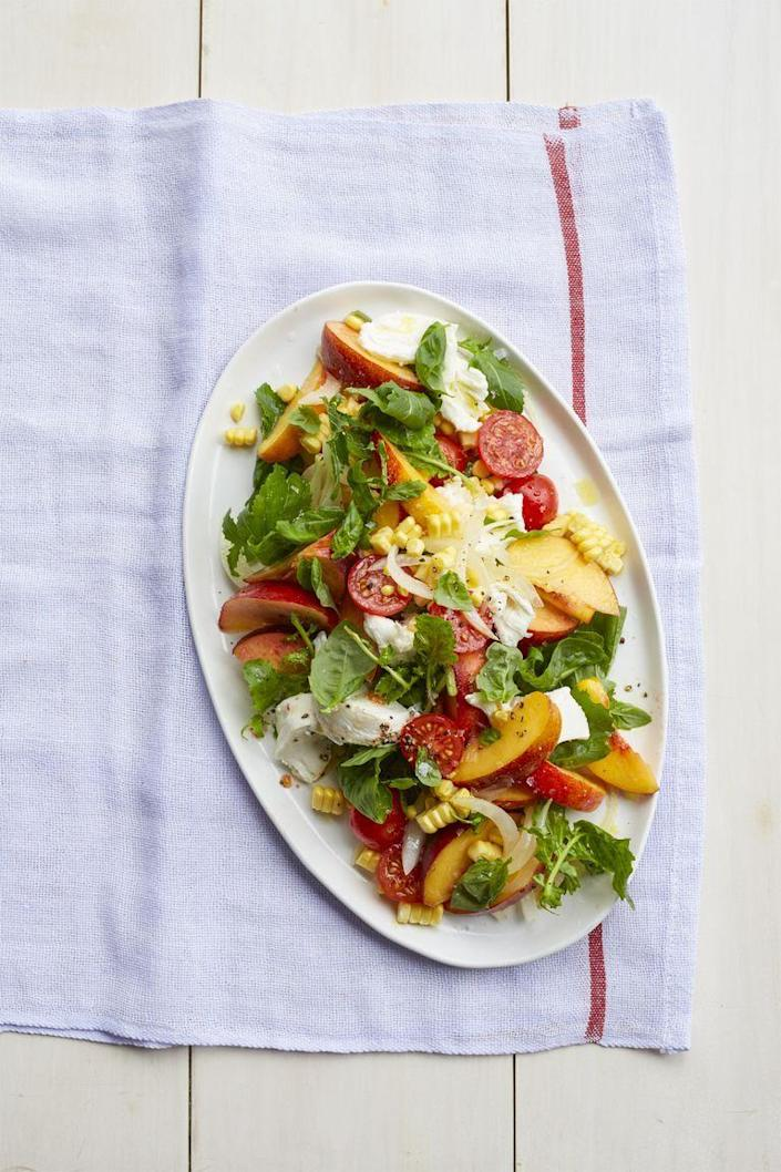 """<p>Give a classic caprese a summer twist with the addition of fresh peaches and corn. </p><p><strong><em><a href=""""https://www.womansday.com/food-recipes/food-drinks/recipes/a55295/peach-caprese-salad-recipe/"""" rel=""""nofollow noopener"""" target=""""_blank"""" data-ylk=""""slk:Get the recipe for Peach Caprese Salad"""" class=""""link rapid-noclick-resp"""">Get the recipe for Peach Caprese Salad</a>. </em></strong></p>"""