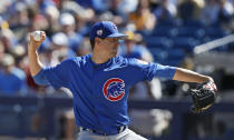 Chicago Cubs' pitcher Kyle Hendricks throws in the first inning of a spring training baseball game against the Milwaukee Brewers, Sunday, March 10, 2019, in Phoenix. (AP Photo/Sue Ogrocki)