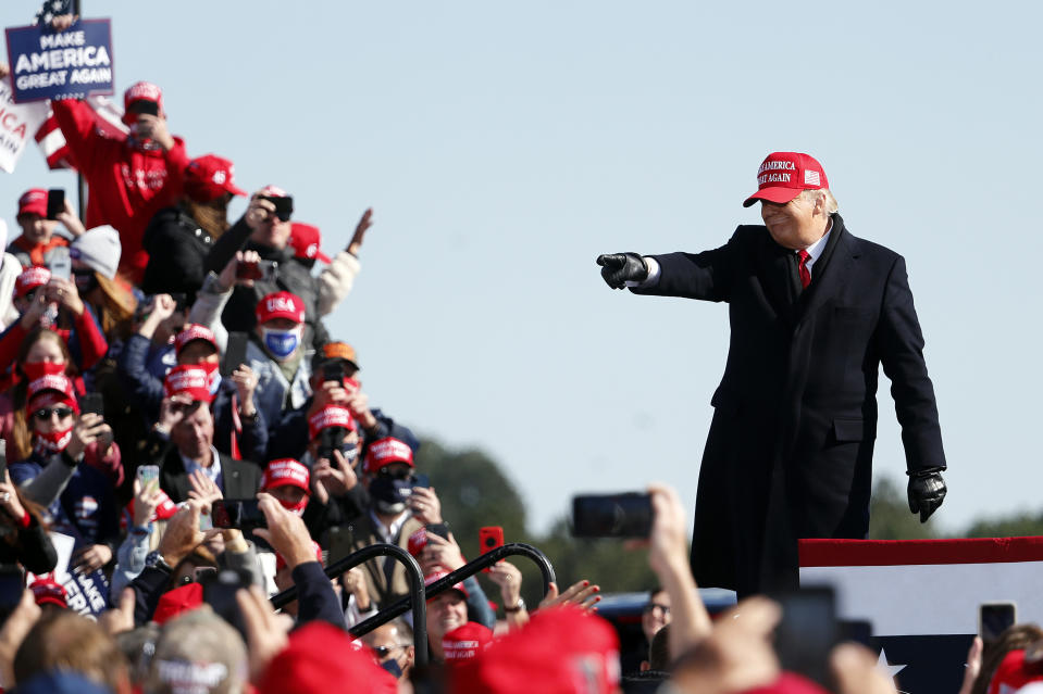 President Donald Trump acknowledges the crowd following a speech at a campaign rally in Fayetteville, N.C., Monday, Nov. 2, 2020. (AP Photo/Karl DeBlaker)