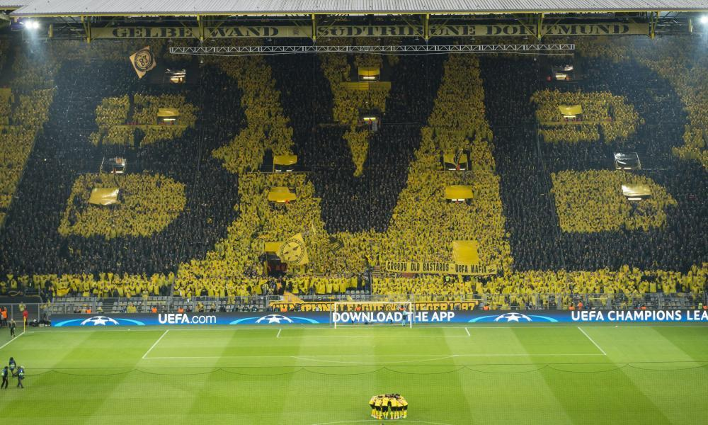 Dortmund's players and fans prepare for the hastily rescheduled match against Monaco.