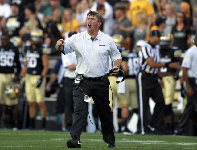 Colorado head coach Mike MacIntyre directs his team against Central Arkansas in the first quarter of a college football game in Boulder, Colo., on Saturday, Sept. 7, 2013. (AP Photo/David Zalubowski)
