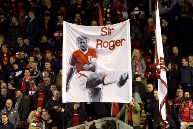 Liverpool fans hold up a banner for ex player Sir Roger (Roger Hunt)