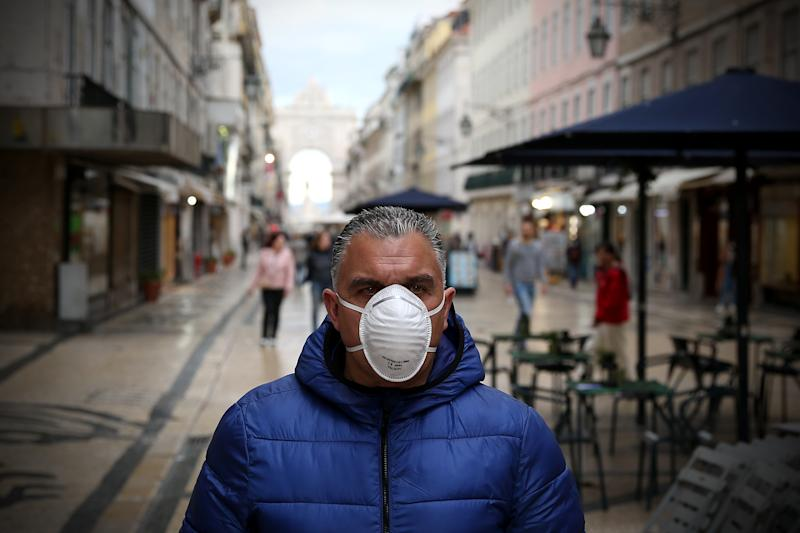 A men wearing a mask is pictured in downtown Lisbon, Portugal, on March 17, 2020. With 448 cases of infection already registered and one confirmed death, the country is feeling the impact of the COVID-19 Coronavirus pandemic. (Photo by Pedro Fiúza/NurPhoto via Getty Images)