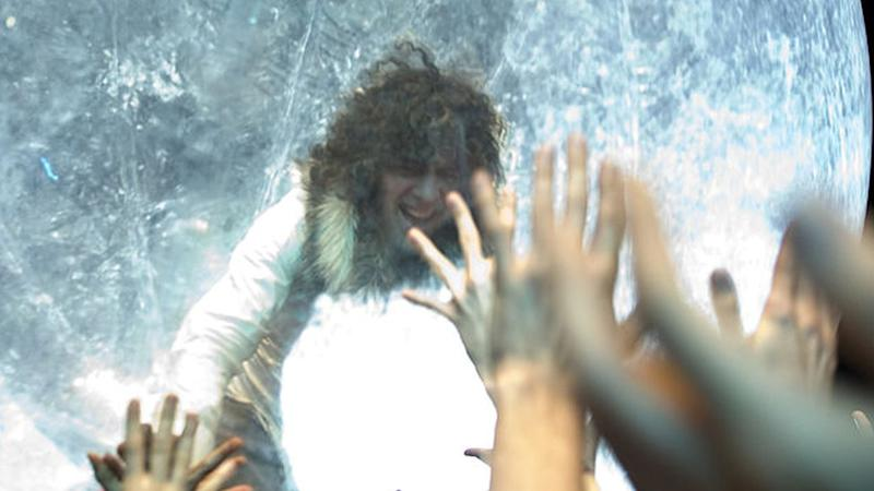 Flaming Lips frontman Wayne Coyne heads out into the crowd in a giant zorb, at Primavera Sound festival Barcelona in 2011
