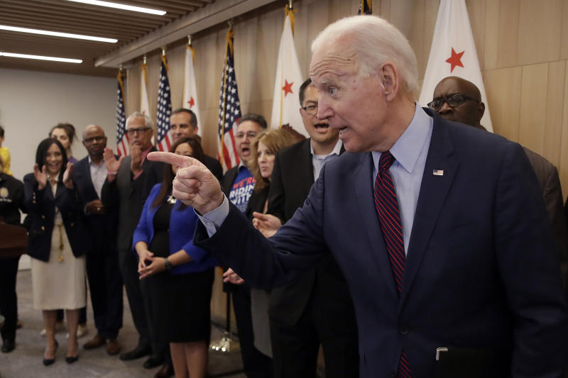 Democratic presidential candidate former Vice President Joe Biden points as reporters ask questions Wednesday, March 4, 2020, in Los Angeles. (AP Photo/Marcio Jose Sanchez)