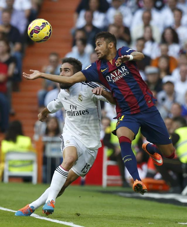"Real Madrid's Daniel Carvajal (L) challenges Barcelona's Neymar during their Spanish first division ""Clasico"" soccer match at the Santiago Bernabeu stadium in Madrid October 25, 2014. REUTERS/Sergio Perez (SPAIN - Tags: SOCCER SPORT)"