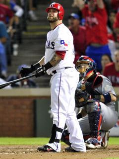 Rangers catcher Mike Napoli watches as his sixth-inning home run leaves his bat in Game 4 of the World Series