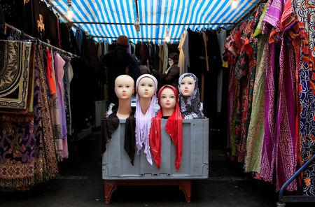 FILE PHOTO: People look at a market stall selling the hijab in east London