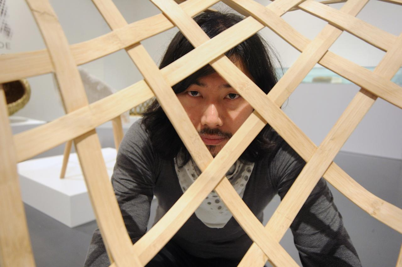 MILAN, ITALY - APRIL 08:  Designer Zhang Lei poses at Triennale di Milano during 2013 Milan Design week on April 8, 2013 in Milan, Italy.  (Photo by Pier Marco Tacca/Getty Images)
