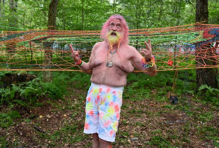 "The self-proclaimed ""Rainbow Man"" feeling the Woodstock vibes in the forest next to farmer Yasgur's homestead"
