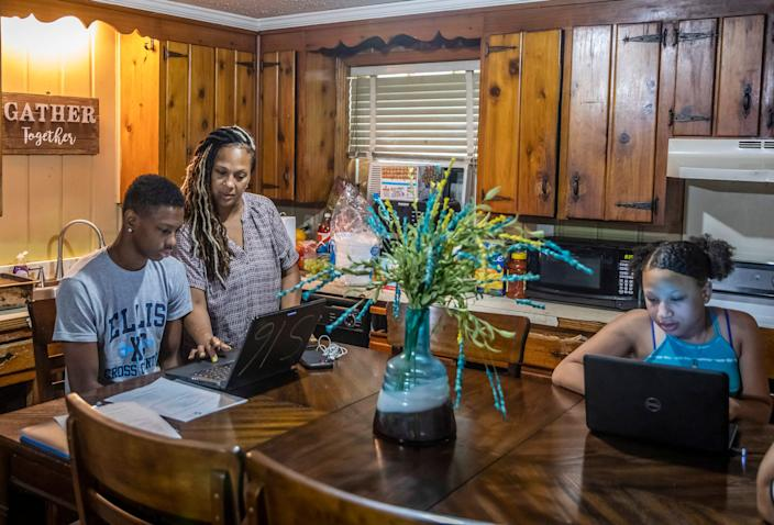 LaTonya Alexander, center, gets virtual learning on the first day of school going with her tenth grade son Wilton and fifth grade daughter Abigail at their home Tuesday August 4, 2020. Wilton attends Maplewood High School and Abigail attends Head Middle Magnet School.