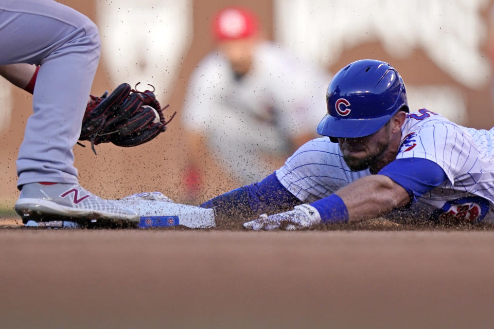 Chicago Cubs' Eric Sogard, right, arrives safely at second after hitting a double as St. Louis Cardinals shortstop Paul DeJong, left, applies a late tag during the third inning of a baseball game in Chicago, Sunday, June 13, 2021. (AP Photo/Nam Y. Huh)