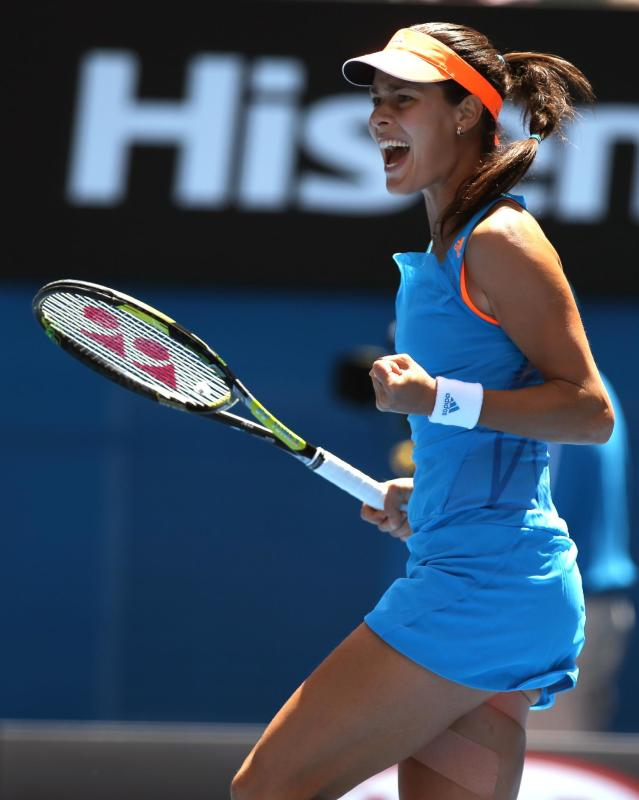 Ana Ivanovic of Serbia celebrates a point won against Serena Williams of the U.S. during their fourth round match at the Australian Open tennis championship in Melbourne, Australia, Sunday, Jan. 19, 2014. (AP Photo/Aaron Favila)