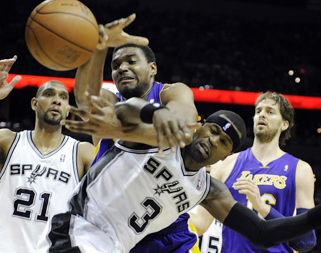 Los Angeles Lakers center Andrew Bynum, top center, and San Antonio Spurs forward Stephen Jackson fight for a loose ball as Spurs forward Tim Duncan, left, and Lakers forward Pau Gasol, right, of Spain, close in during the first half of an NBA basketball game on Friday, April 20, 2012, in San Antonio. (AP Photo/Bahram Mark Sobhani)