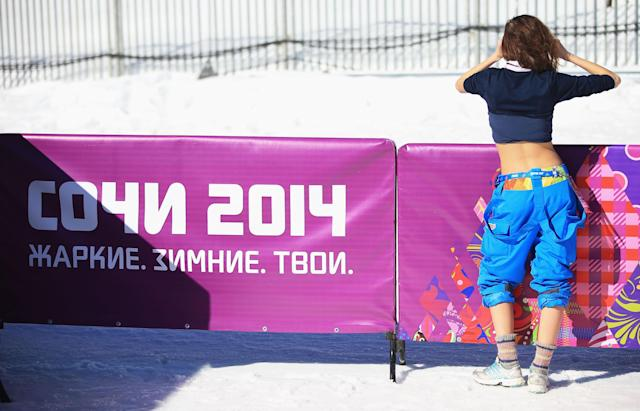 SOCHI, RUSSIA - FEBRUARY 13: A woman wears her shirt and pants rolled up during the Women's 10 km Classic during day six of the Sochi 2014 Winter Olympics at Laura Cross-country Ski & Biathlon Center on February 13, 2014 in Sochi, Russia. (Photo by Richard Heathcote/Getty Images)