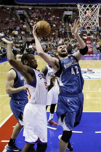 Minnesota Timberwolves' Kevin Love (42) shoots as Philadelphia 76ers' Lavoy Allen defends in the first half of an NBA basketball game, Tuesday, Dec. 4, 2012, in Philadelphia. (AP Photo/Matt Slocum)