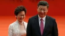 FILE PHOTO: Hong Kong Chief Executive Carrie Lam and Chinese President Xi Jinping walk after Lam took her oath in Hong Kong