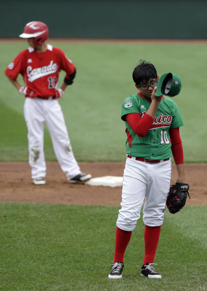Nuevo Laredo, Mexico's Ramon Ballina, right, reacts after walking Vancouver, British Columbia's Cole Dalla-Zanna to load the bases in the first inning of a pool play baseball game at the Little League World Series, Friday, Aug. 17, 2012, in South Williamsport, Pa. Canada won 13-9. (AP Photo/Matt Slocum)