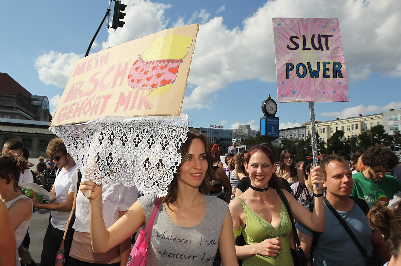 "BERLIN, GERMANY - AUGUST 13:  Young women holding signs that read: ""My Ass Is Mine"" and ""Slut Power"" participate in the ""Slut Walk"" march on August 13, 2011 in Berlin, Germany. Several thousand men and women turned out to protest against rape and a woman's right to her body.   (Photo by Sean Gallup/Getty Images)"
