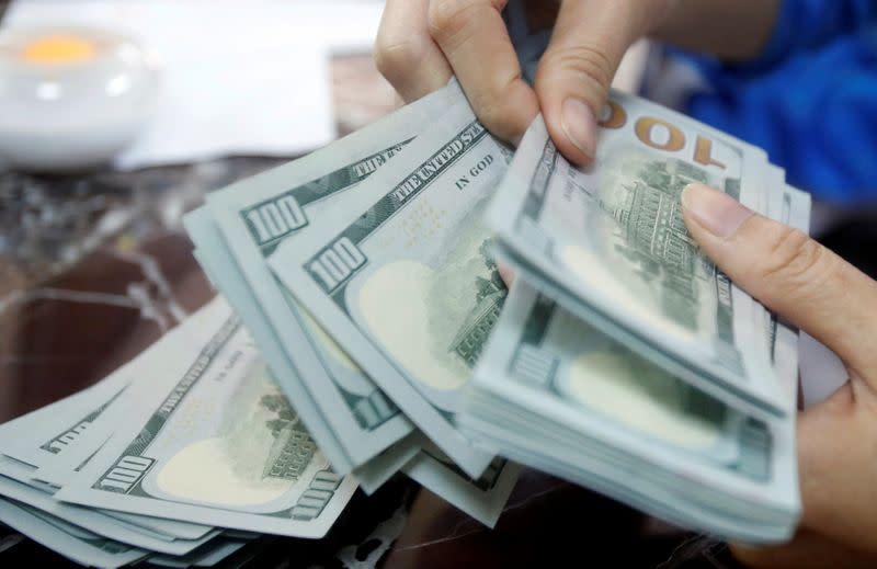 Dollar in tight range ahead of U.S. services sector data