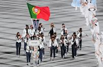<p>Portugal's delegation parade during the opening ceremony of the Tokyo 2020 Olympic Games, at the Olympic Stadium, in Tokyo, on July 23, 2021. (Photo by Martin BUREAU / AFP) (Photo by MARTIN BUREAU/AFP via Getty Images)</p>