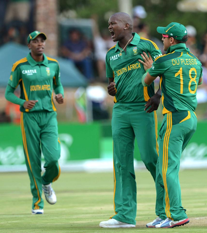 POTCHEFSTROOM, SOUTH AFRICA - JANUARY 25: Lonwabo Tsotsobe of South Africa celebrates with team-mate Faf du Plessis after claiming the wicket of Martin Guptill during the 3rd One Day International match between South Africa and New Zealand at Senwes Park on January 25, 2013 in Potchefstroom, South Africa.  (Photo by Lee Warren/Gallo Images/Getty Images)