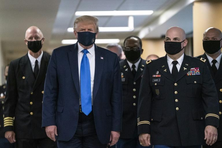 The man in the presidential mask: Donald Trump wore a face mask for the first time in public