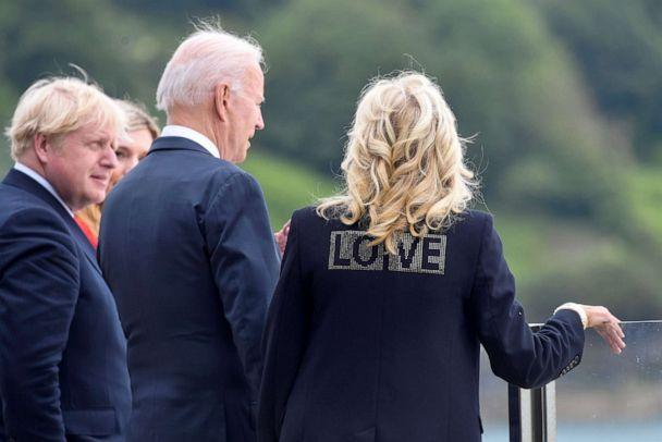 PHOTO: U.S. first lady Jill Biden wears a jacket with the phrase 'Love' as she stands next to U.S. President Joe Biden, Britain's Prime Minister Boris Johnson and his wife Carrie Johnson, during their meeting in Cornwall, Britain, June 10, 2021. (Toby Melville/Reuters)