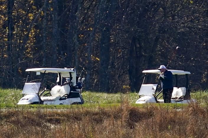 President Trump follows through on a swing at his golf course Saturday morning