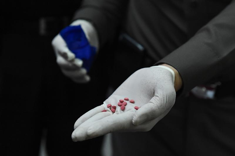 Drug use has flourished in Bangladesh in recent years, with a blend of methamphetamine and caffeine known locally as yaba especially popular among youth (AFP Photo/LILLIAN SUWANRUMPHA)
