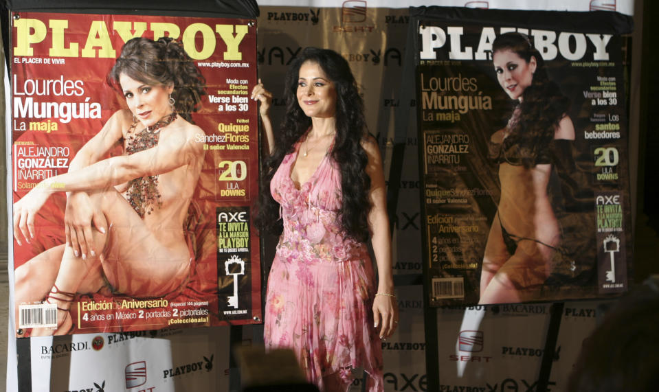 Mexican actress Lourdes Munguia poses next to the two covers of the October 2006 Playboy Mexico magazine during the 4th anniversary of the Playboy Mexico magazine in Mexico City on Monday, Oct. 2, 2006.(AP Photo/Miguel Velasco)