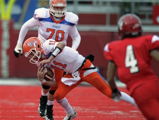 Sam Houston State quarterback Brian Bell (11) runs the ball against Eastern Washington during the first half of an FCS semifinal playoff NCAA college football game on Saturday, Dec. 15, 2012, in Cheney, Wash. (AP Photo/The Spokesman-Review, Tyler Tjomsland)