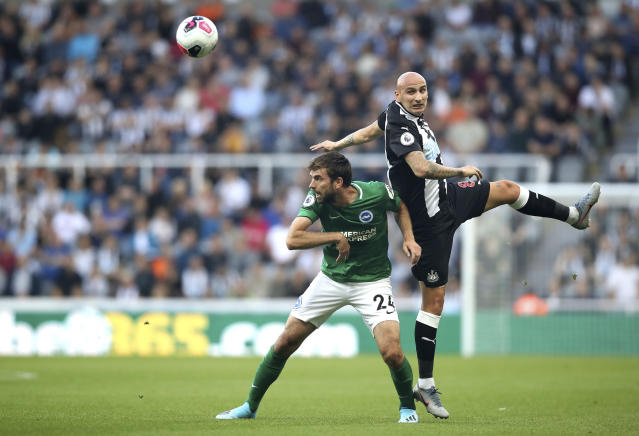 Brighton and Hove Albion's Davy Propper, left, and Newcastle United's Jonjo Shelvey battle for the ball during the English Premier League match at St James' Park, Newcastle, England, Saturday Sept. 21, 2019. (Owen Humphreys/PA via AP)