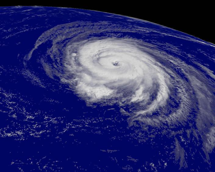 A satellite image shows Hurricane Helene churning over the Atlantic Ocean in 2006. Hurricanes have grown more intense in recent years, though their overall number has declined.