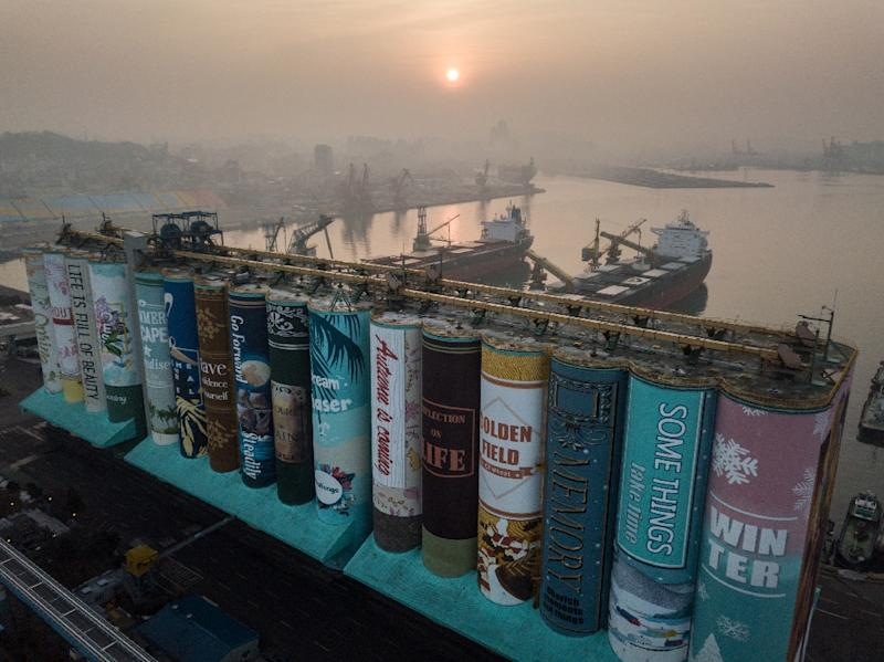 Twenty-two artists used more than 850,000 litres of paint to tell the story, which reflects the seasons and resembles 16 individual book covers (AFP Photo/Ed JONES)