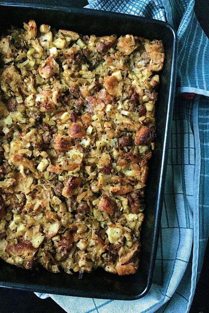 """<p>Torn croissants make this stuffing rich and amazingly buttery.</p><p>Get the <a href=""""https://www.delish.com/uk/cooking/recipes/a29709529/croissant-stuffing-sausage-apples-recipe/"""" rel=""""nofollow noopener"""" target=""""_blank"""" data-ylk=""""slk:Croissant Stuffing with Sausage and Apples"""" class=""""link rapid-noclick-resp"""">Croissant Stuffing with Sausage and Apples</a> recipe.</p>"""