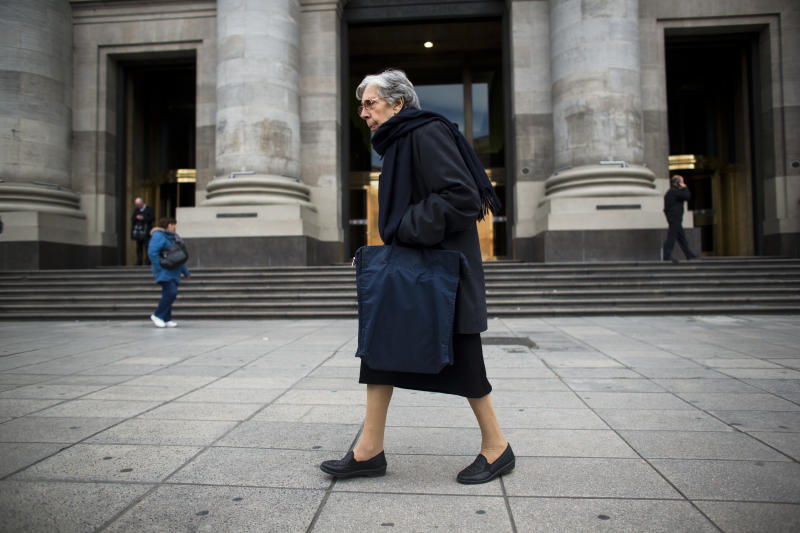 A woman walks in front of Argentina's Central Bank in Buenos Aires, Argentina, Friday, Aug. 23, 2013. A U.S. appeals court dealt Argentina a blow Friday in the lengthy legal battle over the country's massive 2001 default, upholding a ruling ordering it to pay $1.4 billion to bondholders. Argentine officials have warned the impact of a ruling against the country could be severe. The decision also could have major repercussions for other countries trying to decide whether to put lenders before their own citizens as they rebuild their economies. (AP Photo/Victor R. Caivano)