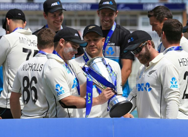 Triumphant skipper - New Zealand stand-in captain Tom Latham holds the trophy following a 1-0 series victory over England clinched by an eight-wicket win in the second Test at Edgbaston on Sunday