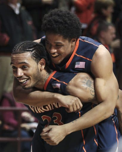 Virginiaís Jontel Evans rides on the back of Mike Scott (23) after Virginia defeated Virginia Tech 61-59 in an NCAA college basketball game in Blacksburg, Va., Tuesday, Feb. 21, 2012. (AP Photo/The Roanoke Times, Matt Gentry)