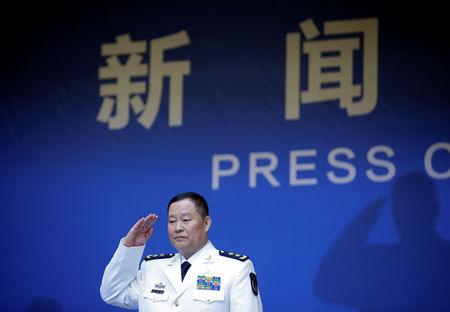 Qiu Yanpeng, deputy commander of the People's Liberation Army (PLA) Navy, arrives at a news conference ahead of the 70th anniversary of the founding of Chinese People's Liberation Army Navy, in Qingdao, China, April 20, 2019. REUTERS/Jason Lee