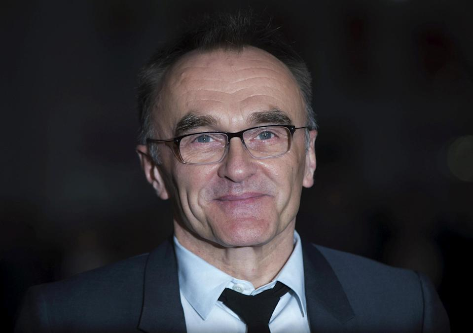 """FILE PHOTO: Director Danny Boyle poses for photographers at the closing night premiere of the film """"Steve Jobs"""" at the BFI London Film Festival October 18, 2015. REUTERS/Neil Hall/File Photo"""