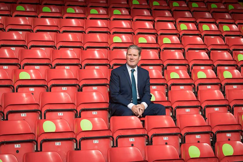 Labour Leader Sir Keir Starmer during a visit to Walsall football club's Banks Stadium to learn about their community work during the pandemic and discuss efforts to reopen sports stadiums in a Covid-secure way (PA)