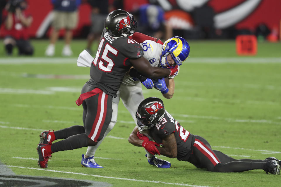 Los Angeles Rams wide receiver Cooper Kupp (10) is stopped by Tampa Bay Buccaneers inside linebacker Devin White (45) and cornerback Sean Murphy-Bunting (23) during the first half of an NFL football game Monday, Nov. 23, 2020, in Tampa, Fla. (AP Photo/Mark LoMoglio)