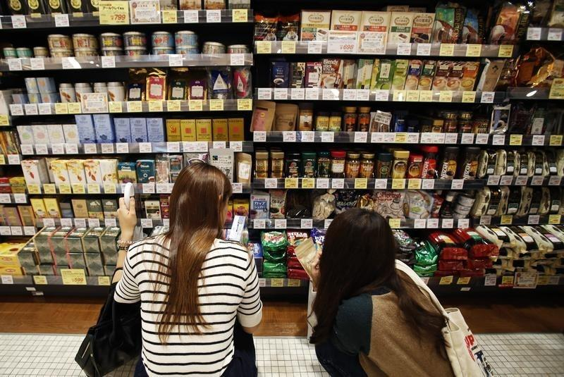 Shoppers look at packs of sugars at a luxury food store in Tokyo